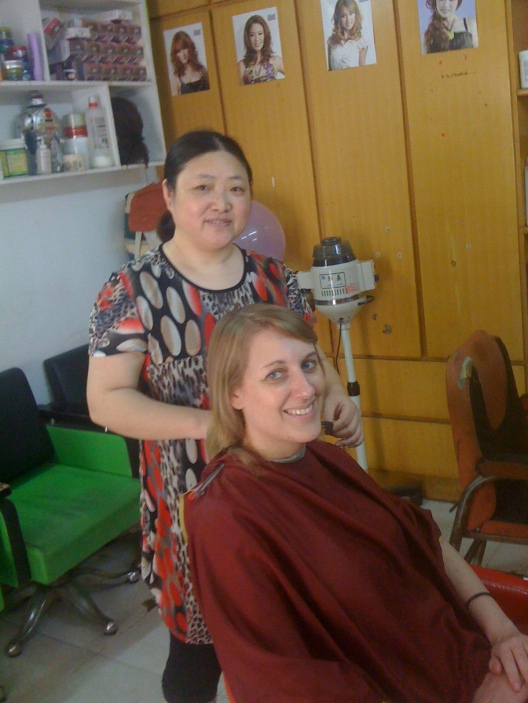 Getting my haircut by the local hairdresser.